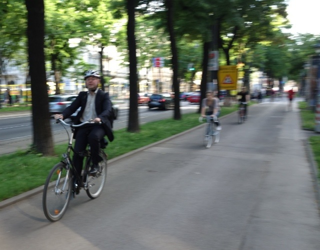 Auto Traffic Is Snarled, While Two-wheel Commuters Fly By On This Tree-lined Bike Path Along The Ringstrasse.